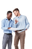 African-American and Caucasian businessman looking at documents Royalty Free Stock Photography