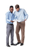 African-American and Caucasian businessman looking at documents Royalty Free Stock Photo