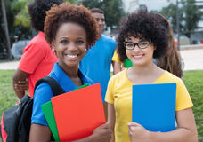 African american and caucasian female student with group of mult Royalty Free Stock Photo