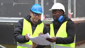 Engineers at work on construction site stock video footage