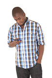 African American checking his phone Royalty Free Stock Images
