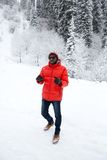 African American Cheerful black man in ski suit in snowy winter outdoors, Almaty, Kazakhstan Royalty Free Stock Image