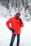 African American Cheerful black man in ski suit in snowy winter outdoors, Almaty, Kazakhstan Stock Images