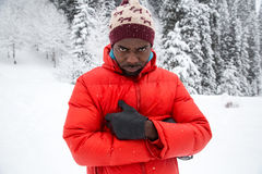 African American Cheerful black man in ski suit in snowy winter outdoors, Almaty Royalty Free Stock Images