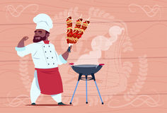 African American Chef Cook Hold Kebab Smiling Cartoon Restaurant Chief In White Uniform Over Wooden Textured Background Royalty Free Stock Image