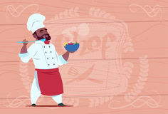 African American Chef Cook Holding Plate With Hot Soup Smiling Cartoon Chief In White Restaurant Uniform Over Wooden. Textured Background Flat Vector Royalty Free Stock Photography