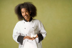 African American Chef Holding Bowl with Cream Stock Image