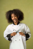 African American Chef Holding Knife and Sharpener Royalty Free Stock Photo