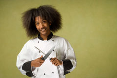 African American Chef Holding Knife and Sharpener Royalty Free Stock Image