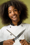 African American Chef Holding Knife and Sharpener Stock Image