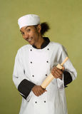African American Chef Holding Rolling Pin Stock Photo