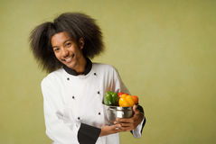african american chef holding vegetables washed Стоковая Фотография RF