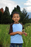 African American Child. Happy African American child playing in a meadow Royalty Free Stock Photography
