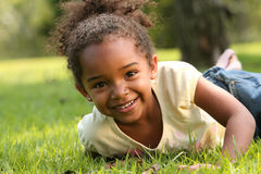 African American Child. Happy African American  Child in a park Royalty Free Stock Image