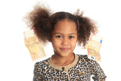 African American child with Asiatic black money. On hair metisse curly euros Royalty Free Stock Photography