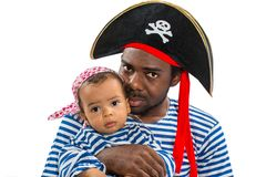African american child boy and father in costume pirate on white background. Baby Halloween Fancy Costume and holiday Stock Photography