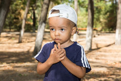 African American child boy in park on nature at summer. Use it for baby, parenting or love concept Royalty Free Stock Image