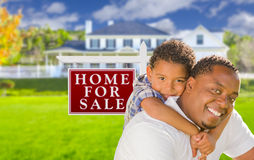 African American Child with Father In Front of Sale Sign and House Stock Photo