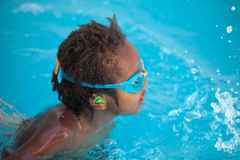 African American child with goggles in the pool Royalty Free Stock Photography