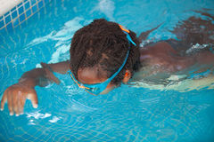 African American child with goggles in the pool Royalty Free Stock Images