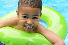 African American Child Swimming. Happy African American child in a swimming pool Stock Image
