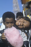 African-American children eating cotton candy, Natchez, MI Royalty Free Stock Photo