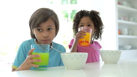 African American Children Having Breakfast In Kitchen stock video