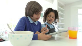 African American Children Use Digital Tablet Over Breakfast Stock Photos