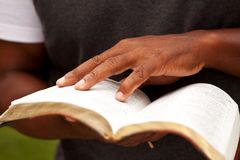 Close up of a man reading the Bible. Stock Image