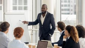 African american coach talking to audience giving presentation on flipchart stock photos