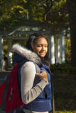 African-American Coed. African_american/Hispanic coed on campus with vest and backpack royalty free stock images