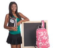 African American College student by blackboard Stock Photo