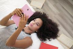Hispanic Girl Using Digital Tablet For School Homework Royalty Free Stock Image