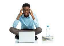 African american college student with headache sitting on white Stock Images
