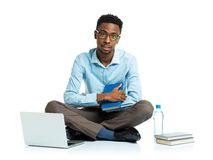 African american college student with laptop, books and bottle o Stock Photo