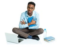 African american college student with laptop, books and bottle o Stock Photos