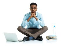 African american college student with laptop, books and bottle o Royalty Free Stock Photography