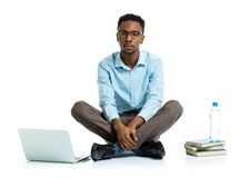 African american college student sitting with laptop on wh Royalty Free Stock Image