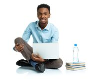 African american college student sitting with laptop on white ba Royalty Free Stock Image