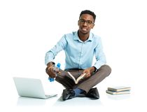 African american college student sitting with laptop on white ba Stock Photography