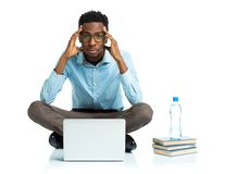 African american college student sitting with laptop on white Royalty Free Stock Photography