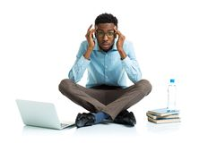 African american college student in stress sitting with laptop, Royalty Free Stock Photography