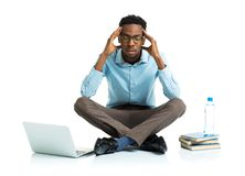 African american college student in stress sitting with laptop, Stock Photos