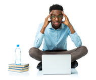 African american college student in stress sitting with laptop, Royalty Free Stock Photos