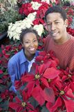 African American Couple Buying Flowers Stock Photo