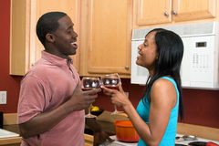 African American Couple Clinking Wine Glasses-Hor Royalty Free Stock Photography