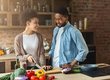 African american couple cooking healthy food together Royalty Free Stock Image