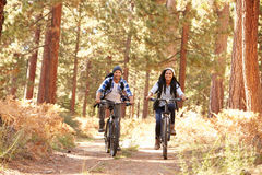African American Couple Cycling Through Fall Woodland Royalty Free Stock Photography