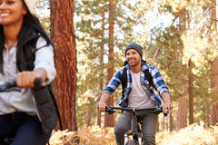 African American Couple Cycling Through Fall Woodland Royalty Free Stock Photo