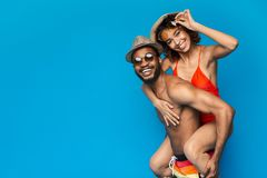 African american couple fooling, man piggybacking his girlfriend stock photo